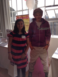 'A' posing with one of the One Direction dudes, do NOT ask me which one ;)